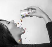 Drinking pills Stock Photo