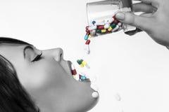 Drinking pills Stock Photography