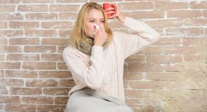 Drinking plenty fluid important for ensuring speedy recovery from cold. Cold and flu remedies. Drink more liquid get rid. Of cold. Girl hold tea mug and tissue royalty free stock images