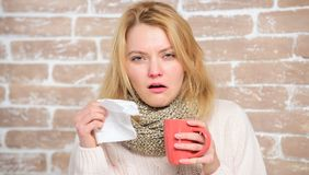 Drinking plenty fluid important for ensuring speedy recovery from cold. Girl hold tea mug and tissue. Runny nose and. Other symptoms of cold. Cold and flu stock photo