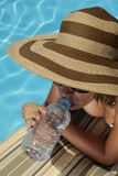 Drinking by the Pool Royalty Free Stock Photo