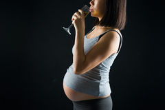 Drinking Pregnant Mother On A Over Dramatic Dark Light Background Stock Photo
