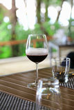 Drinking the red wine in the restaurant. At the hotel Royalty Free Stock Photos