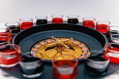 Drinking roulette. drinking game spirits stock photos