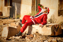 Drinking Santa. A stressed out Santa indulging in a bottle of champagne Royalty Free Stock Photography