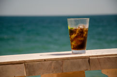 Drinking by the sea Stock Photography