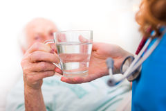 Drinking senior patient Stock Image
