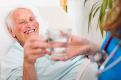 Drinking senior patient Royalty Free Stock Photography