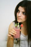 Drinking smoothie Stock Photos