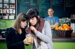 Drinking smoothies Stock Images