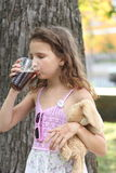 Drinking soft drink Royalty Free Stock Photo