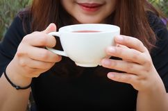 Drinking some tea or hot tea or hot rose tea. Someone is drinking some tea or hot tea or hot rose tea stock image