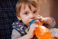 Drinking some water from a bottle Stock Photo