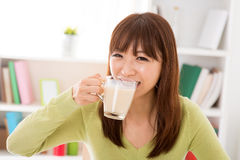 Drinking soy milk Royalty Free Stock Photos