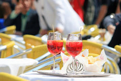 Aperitiv in a bar. Drinking a spritz outside a bar in a sunny day Royalty Free Stock Photography