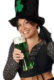 Drinking on St Patricks Day. Pretty female with pigtails and hat drinking a tall glass of green beer on St. Patricks Day Stock Photos