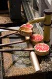Drinking station, Kiyomizu Shrine in Kyoto, Japan. Water drinking station at Kiyomizu Shrine in Kyoto, Japan during springtime cherry blossom Sakura season Royalty Free Stock Images