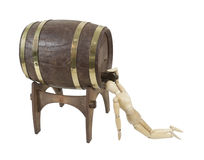 Drinking Straight from Wooden Barrel on Stand Royalty Free Stock Photography