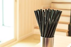 Drinking straw black in glass stainless steel. stock photography