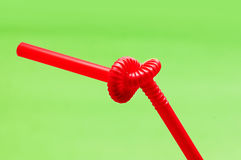Drinking straw. Isolated on green royalty free stock image