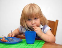 Drinking on straw little girl Stock Images