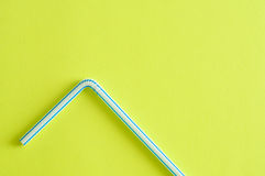 A drinking straw. On a yellow background Stock Images