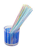Drinking Straws. In a blue glass. Isolated Royalty Free Stock Photos