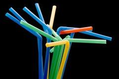 Drinking straws on black Stock Photography