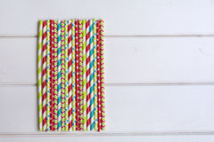 Drinking Straws. Colorful paper straws on white wooden background. Event and party supplies Royalty Free Stock Photo