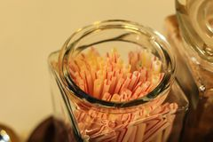 Drinking straws in the glass color. royalty free stock photos