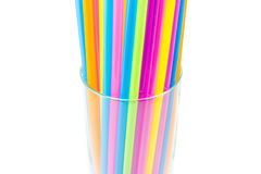 Drinking straws in glass isolated on white background Stock Photography