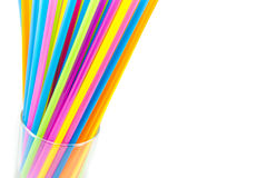 Drinking straws in glass isolated on white background Royalty Free Stock Photos