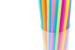 Drinking straws in glass isolated on white background Royalty Free Stock Images