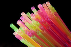 Drinking Straws. Plastic drinking straws on black background Stock Images