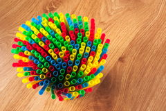 Drinking straws stapled together on the table top view. Colorful drinking straws on a wooden background Stock Image