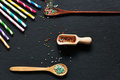 Drinking straws and sugar sprinkle dots Stock Photo