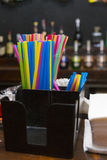 Drinking straws. On a table in a bar Royalty Free Stock Image