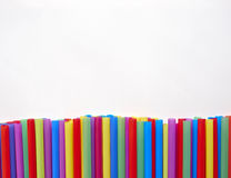 Drinking straws on white paper, space for typing Royalty Free Stock Photo