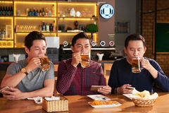 Drinking tasty beer Royalty Free Stock Images