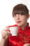 Drinking tea. A beautiful young woman holding a cup of tea Stock Images