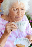 Drinking tea lady Royalty Free Stock Images