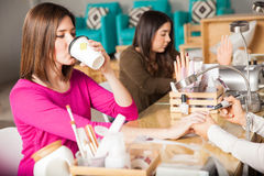 Drinking tea at a nail salon Royalty Free Stock Photo