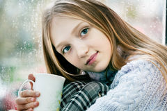 Drinking Tea in the Rainy Day Royalty Free Stock Photography
