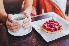 tea with sweet cake dessert in cafe, close up of hands royalty free stock photos