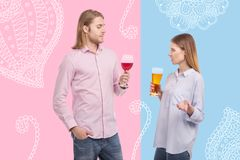 Emotional couple standing together and drinking alcohol royalty free stock photography