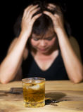 Drinking too much. Dark portrait of a woman with an alcoholic drink and car keys Stock Images