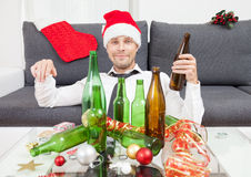 Drinking too much during Christmas time Royalty Free Stock Image