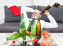 Drinking too much during Christmas time Royalty Free Stock Photo