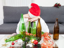 Drinking too much during Christmas time stock photos