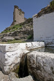Drinking trough for farm animals and castle, Sabiote Stock Photography